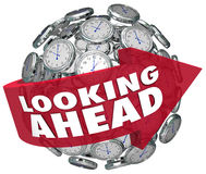 Looking Ahead Time Clock Forecasting Prediction Future. Looking Ahead words on arrow around clocks to illustrate seeing the future by predicting what will happen Stock Photos