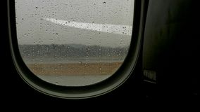 Looking through airplane window. At airport stock video footage