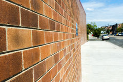 Looking along a Brick Wall Stock Photos