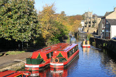 Looking along Springs Canal, a short branch off the Leeds and Liverpool Canal in Skipton, North Yorkshire with several canal boats Royalty Free Stock Photography