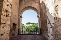 Looking Through Arch in Coliseum. View of countryside through an arch in the ancient Roman Coliseum Stock Photos