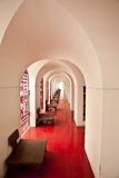 Looking through arched doors and red floor in castle Stock Photos