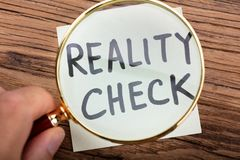 Free Looking At Reality Check Word Through Magnifying Glass Royalty Free Stock Images - 148992879