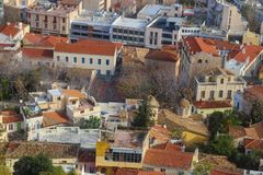 Looking from the Athens Acropolis down onto the rooftops of Athens with their tile roofs and rooftop patios - some very grungy and stock photography