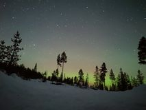 Looking at Aurora at night in Finland stock photography