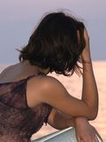 Looking away. Young woman sitting and lookin at horizon, holding book Royalty Free Stock Photo