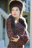 Looking away Russian beauty in traditional fur Cossack hat and crossed arms Stock Photography