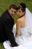 Looking back. Wedding pair on the lawn - looking back Royalty Free Stock Images