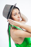 Looking back while holding her hat. Stock Photos