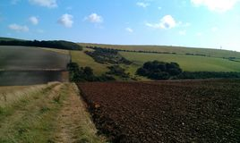 Looking back at Newmarket Forest. Falmer farmland looking towards Woodingdean Royalty Free Stock Photo