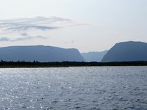Looking back from the tour boat at the end of the fjord of the W stock image