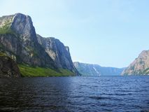 Looking back from the tour boat at the end of the fjord of the W. Estern brook pond in Gros Morne National Park, Newfoundland and Labrador, Canada Stock Photos