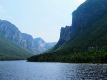 Looking back from the tour boat at the end of the fjord of the W. Estern brook pond in Gros Morne National Park, Newfoundland and Labrador, Canada Royalty Free Stock Photo