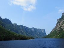 Looking back from the tour boat at the end of the fjord of the W. Estern brook pond in Gros Morne National Park, Newfoundland and Labrador, Canada Royalty Free Stock Image