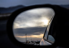 Looking back. View from my car mirror royalty free stock photo