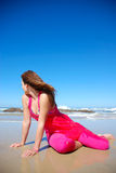 Looking back woman. A caucasian young woman sitting in the wet sand on the beach and looking back to the sea in summertime stock photos