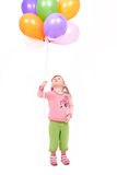 Looking at balloons Stock Photos