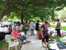 Looking for Bargains. Photo of people at a flea market on 6/3/17 in a a washington dc neighborhood. They are shopping for bargains from sellers who want to get Royalty Free Stock Photography