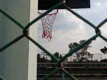 Basketball. Looking basketball court form net Stock Images