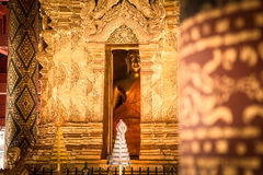 Looking behind the pillar. The view of the Buddha image from behind the pillar in a temple in Thailand Royalty Free Stock Photos
