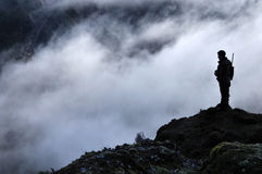 Looking for the big one. Silhouette of a hunter scoping for Himalayan tahr in the Southern Alps of New Zealand Stock Photos