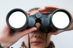 Looking through binocular Stock Photo