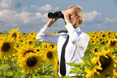 Looking through binoculars Royalty Free Stock Photography