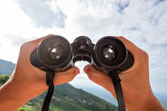 Looking through the binoculars. Concept of active travel stock photography