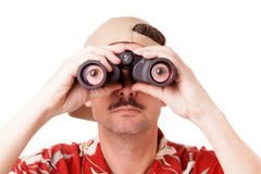 Looking through binoculars Stock Photo
