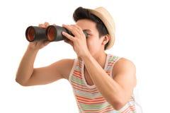 Looking through binoculars Royalty Free Stock Photo