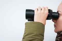 Looking through binoculars Royalty Free Stock Photos