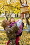 Mother and daughter with birdhouse in autumn park Stock Photography