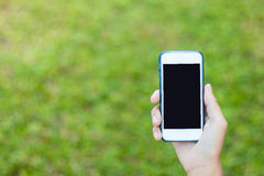 Looking on a blank screen. On modern mobile phone screen with right hands Stock Images