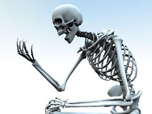 Looking At A Bone Hand. A skeleton looking at its own bony hand Stock Photos