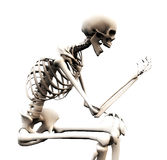 Looking At A Bone Hand. A skeleton looking at its own bony hand Royalty Free Stock Images