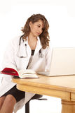 Looking in book doctor Royalty Free Stock Photo