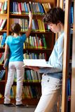 Looking through books Stock Photo