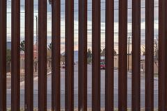 The US Border with Mexico. Looking at the border fence between the USA and Mexico, with a town in Mexico visible on the other side royalty free stock image
