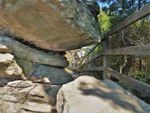 Looking Between Boulders at Pilot Mountain State Park. Large boulders partially block the path along the pinnacle trail at Pilot Mountain State Park in North royalty free stock photo