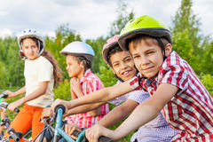 Looking boy in helmet with his friends behind Stock Image