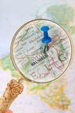 Looking in on Brussels, Belgium, Europe. Blue tack on map of Benelux with magnifying glass looking in on Brussels, Belgium Stock Photos