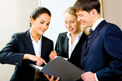 Looking at business plan Stock Photography