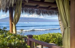 Looking through the Cabana. An inviting cabana on Kaanapali Beach on a sunny warm morning Stock Photo
