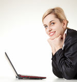 Looking at the camera businesswoman with laptop Stock Images