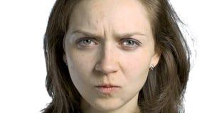 Looking at camera grumpy woman stock video footage