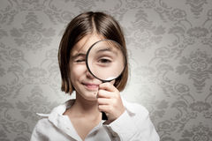 Looking at camera through magnifying glass Royalty Free Stock Photography