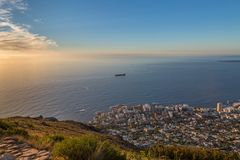 Looking at Cape Town from Lion`s Head Mountain. Looking down on the sunset over the Cape Peninsula and Cape Town from Lion`s Head Mountain stock images