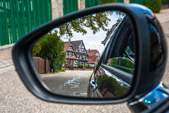 Looking through the car mirror to the streets of Seebach Stock Images