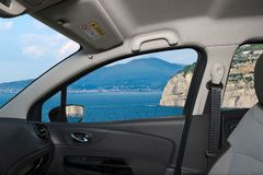 Car window view of the volcano Vesuvius, Naples, Italy. Looking through a car window with view of the iconic volcano Vesuvius from Sorrento Town in the Bay of Stock Photography