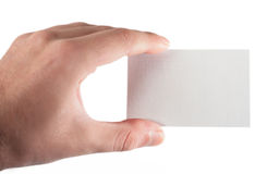 Looking at the card. A hand holding a business card Stock Image